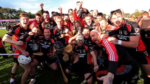 The Oulart players celebrate victory over