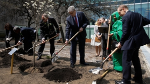 United Nations diplomats plant a Dogwood tree in the UN Food Garden to mark the Paris agreement