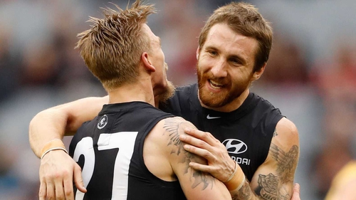 Zach Tuohy (R) has penned a four-year deal with Geelong