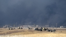 Kurdish peshmerga forces are seen near Mosul as they battle to recapture the village of Tiskharab from IS