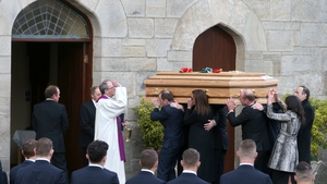 Anthony Foley's coffin is carried into St Flannan's Church in Killaloe