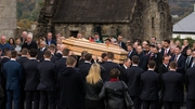 The coffin of Munster head coach Anthony Foley leaves St Flannan's Church
