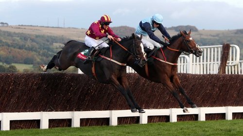 Heron Heights (near side) and Full Cry clear the last at Prestbury Park