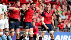 Munster's forwards celebrate the bonus-point penalty try