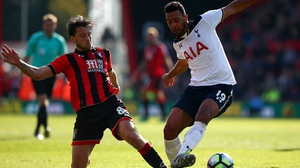Harry Arter (L) challenges Mousa Dembele of Tottenham