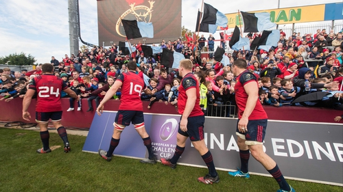 Munster players acknowledge a group of Shannon fans after the game