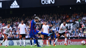 Lionel Messi slots home the winning penalty against Valencia