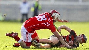 Ballygunner's Eddie Hayden battles with Passage's John Whitty at Walsh Park