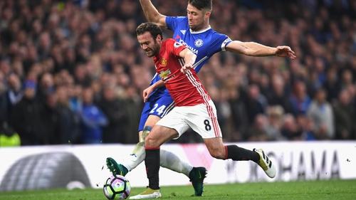 Mata takes on Chelsea defender Gary Cahill at Stamford Bridge