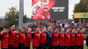 Munster players observe a minutes silence before kick-off against Glasgow Warriors