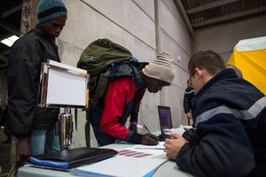 Aid workers were advising refugees and migrants to register for the buses together as they believe this will give certain groups of friends or communities the best chance of not being separated