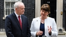 Northern Ireland Deputy and First Ministers Martin McGuinness (L) and Arlene Foster speaking outside No 10 Downing St