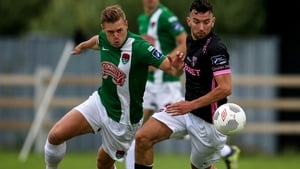 Cork CIty's Ian Turner battles for possession with Wexford's Shane Dunne