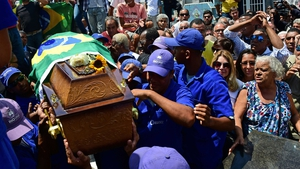 Former capitan of Brazil's 1970 World Cup winning team, Carlos Alberto Torres, is buried at Irajá cemetery in Rio de Janeiro, Brazil on October 26, 2016. Carlos Alberto, the revered captain of Brazil's 1970 World Cup-winning side, considered one of the gr