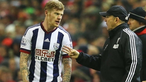 Tony Pulis (R) passes on instructions to Republic of Ireland winger James McClean
