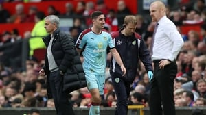 Burnley's Stephen Ward leaves the field of play with an injury