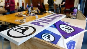 Pirate Party members speak to voters in 'Tortuga', their campaign HQ in Reykjavik