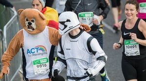 A Stormtrooper and an Ewok support each other