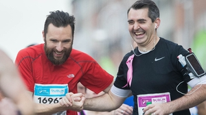 These runners share a joke along the way