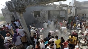People search through the rubble after the attack