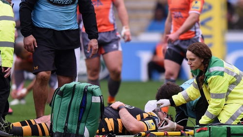 Marty Moore receives treatment on the Ricoh Arena pitch