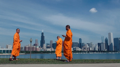Lo and Behold: Buddhist monks check their phones on a deserted Chicago morning in Werner Herzog's intriguing exposé.