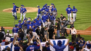 The Chicago Cubs celebrate after defeating the Cleveland Indians