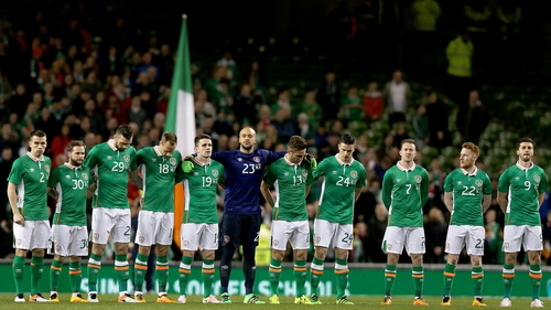The Republic of Ireland team observes a minute's silence during the March friendly with Switzerland