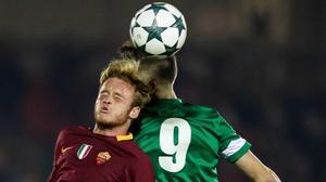 Cork's Aaron Drinan rises with Lorenzo Grossi of Roma