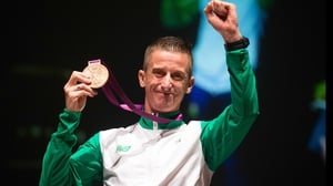 Rob Heffernan salutes the crowd as he receives his bronze medal