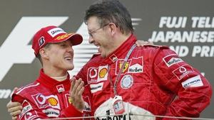 Schumacher and Brawn after winning the 2004 world title