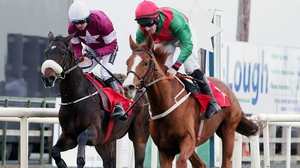 Rahsaan ridden by Sean Flanagan (right) beats Apple's Jade ridden by Ruby Walsh to win