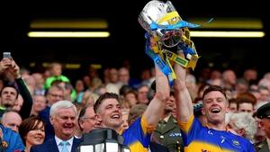 Ronan (L) and Padraic Maher lift the Liam MacCarthy Cup