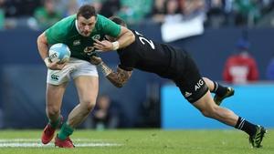 Robbie Henshaw breaks through the tackle of Aaron Cruden