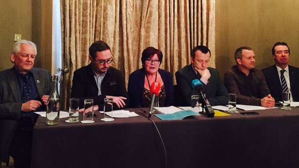 Joan Collins, centre, announces bill on water ownership