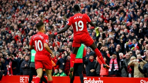 Sadio Mane celebrates his opening goal against Watford