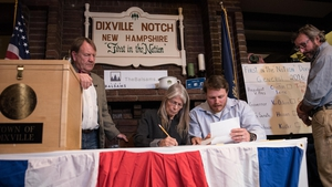 Clerks tabulate ballots at a polling station just after midnight in Dixville Notch, New Hampshire, the first voting to take place in the 2016 US presidential election