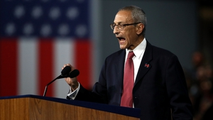 Campaign chairman John Podesta told the crowd that the election was still too close to call