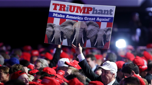 A supporter holds up a sign in support of Republican presidential nominee Donald Trump