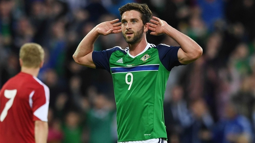 Will Grigg celebrates a friendly goal against Belarus