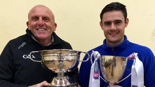 Slaughtneil chairman Sean McGuigan and dual player Chrissy McKaigue with some of the silverware they won this season