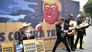 Mexican activists protest against Donald Trump in front of a specially made scenery wall in Mexico City