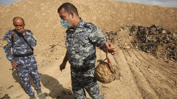 Iraqi forces near a mass grave they discovered in the Hamam al-Alil area