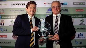 Ed Joyce receives the award from Cricket Ireland chairman Ross McCollum