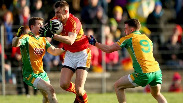 Corofin's Gary Sice and Ronan Steede try to tackle Barry Moran in last year's final