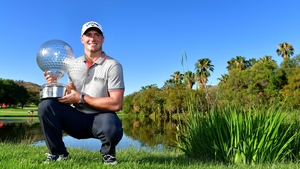 Alex Noren poses with his trophy at the Gary Player Country Club