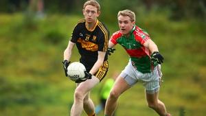 Colm Cooper under pressure from Noel McGrath
