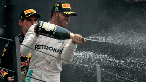 Hamilton celebrates winning the Brazilian Grand Prix