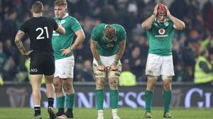 Ireland's Finlay Bealham, Jamie Heaslip and Josh van der Flier after defeat