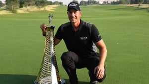 Henrik Stenson  poses with the Race to Dubai trophy